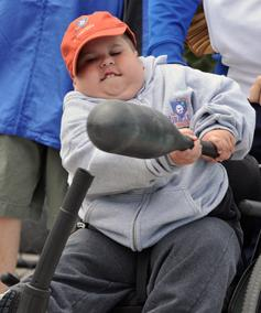 Boy in wheelchair batting
