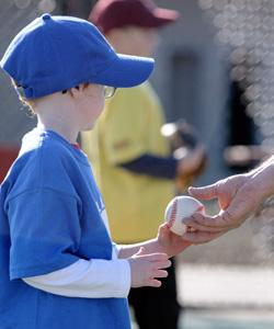 Little boy in blue with baseball