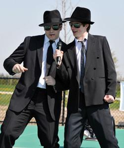2 boys dressed in suits